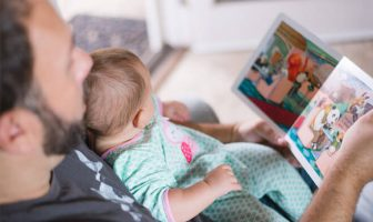 Dads can read the newborn a bedtime story for some quality bonding